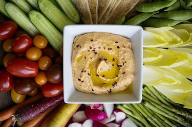 Homemade hummus with a platter of vegetables