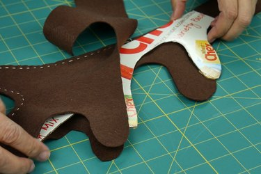 Slide cardboard between layers of felt and stitch in place.