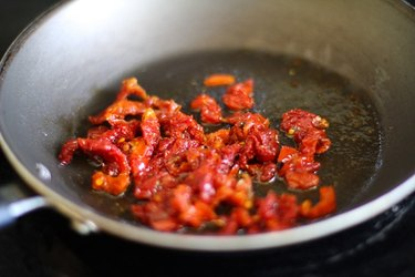 Sun-dried tomatoes in a skillet.