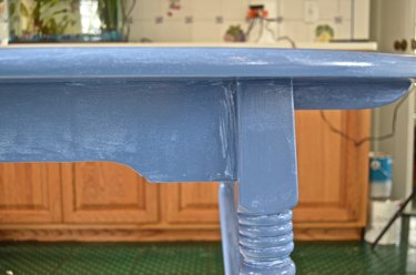 First coat of latex paint on table