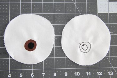 Sew the iris and pupil using a small zig zag stitch