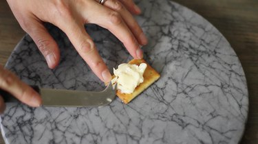 trying to spread brie on a cracker
