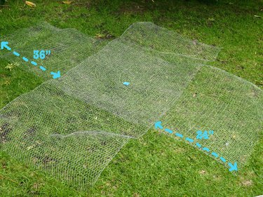 "A large ""X"" of chicken wire on the ground, measuring 7 and 8 feet."