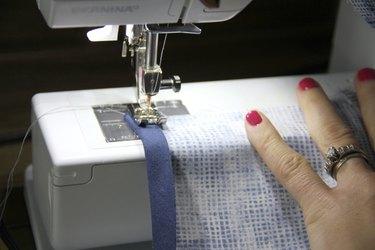 sew bias tape to raw leg seam