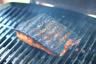 Salmon on a grill with char marks
