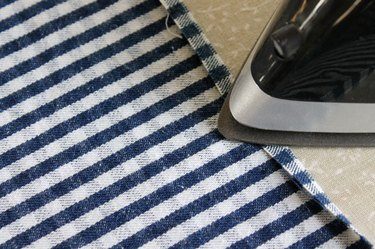 Press under a 1/4 inch of the new hem.