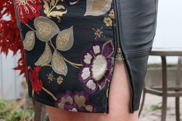 Close up of the zipper on the leather skirt.