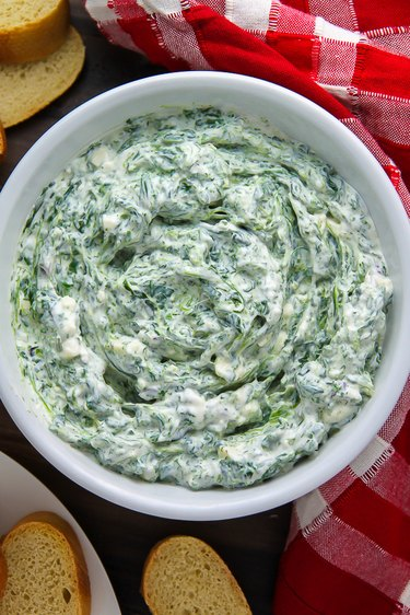 Spinach dip with baguette.
