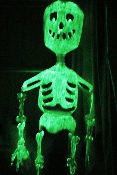 milk jug skeleton painted with glow in the dark paint