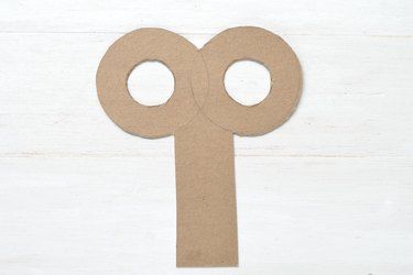 Cut out both small circles to complete the key shape.
