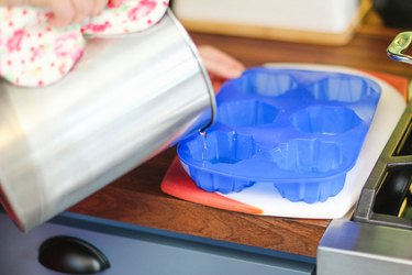 Pour melted wax into the mold.
