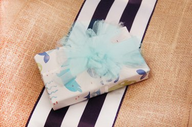 Mesh ribbon can transformed into small pom poms perfect for topping your gifts.