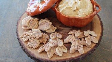 Serving pumpkin spice dip and pie crust cookies