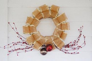 Weave mesh ribbon through a wreath mold to make a fun and festive wreath.