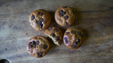 Fresh-baked peanut butter banana blender muffins topped with chocolate chips