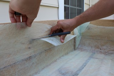 cut excess fabric with scissors | how to make an elevated planter box