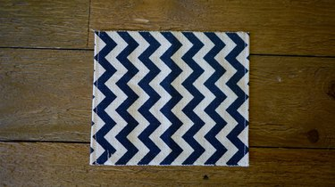 Fabric hemmed on two sides.