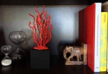 DIY faux coral sculpture on a bookshelf.