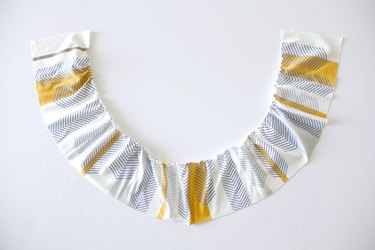 Sew a gathering stitch along the top of your ruffle