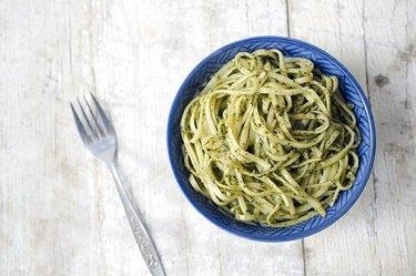 A bowl of linguine pasta.