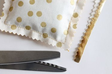Use pinking shears to trim around the sachet.