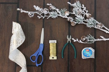 Items needed to create a Christmas tree bow topper.