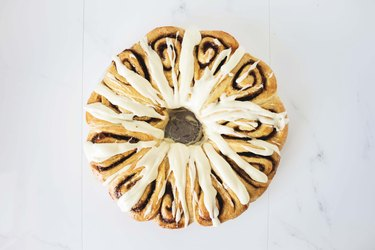 Cinnamon Roll Wreath drizzled with the cream cheese glaze.