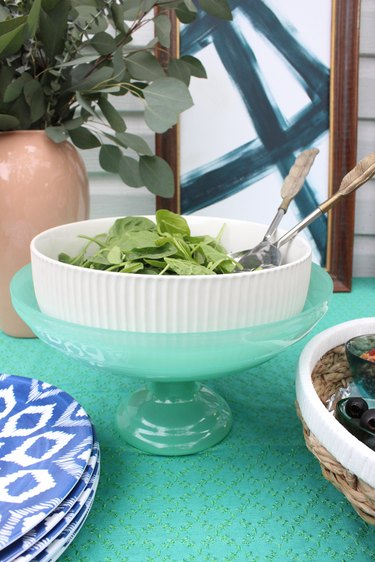 Layer ice in a footed bowl and place a serving bowl on top.