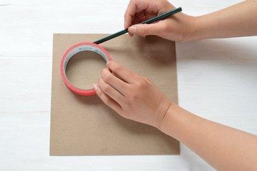 Drawing circle on cardboard