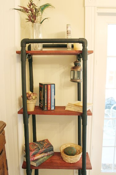 finished bookshelf made from pvc pipe and wood