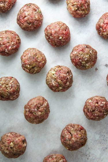 Roll meatballs into 2 tablespoon sized balls.