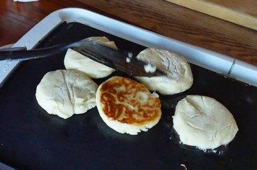 Cook pancakes, flipping halfway through.