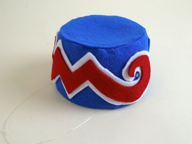 The finished cap with the felt zigzag designs.