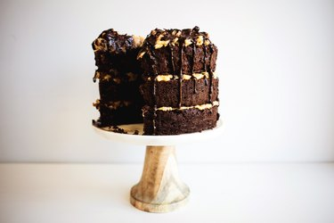 A German chocolate cake displayed on a cake stand.