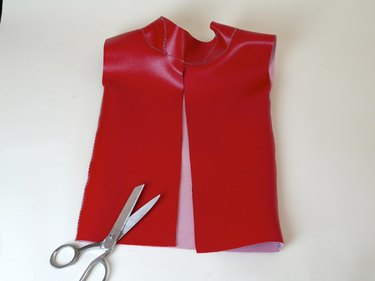 The back of the vinyl top cut from the base to the collar.