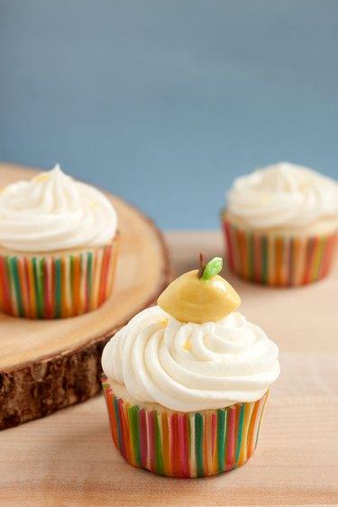 Lemonade cupcake with DIY lemon-shaped candy cupcake topper