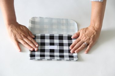 press oilcloth with hands
