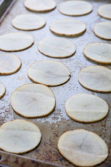 Potato slices on a baking sheet