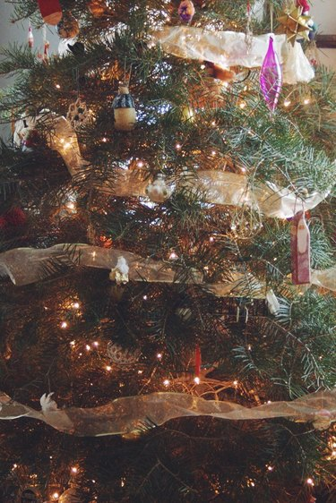 Adding mesh ribbon to your tree creates a charming and elegant glow.