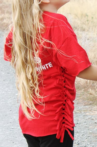 little girl wearing side-knotted t-shirt