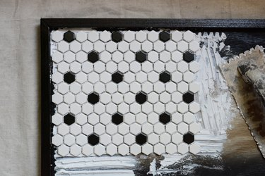 place tile sheets in mastic