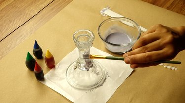 Coating glass with glue mixture to create a faux sea glass effect on glass decor.