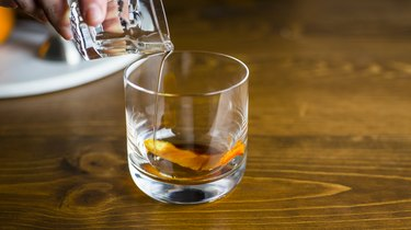 Pouring the simple syrup into the glass