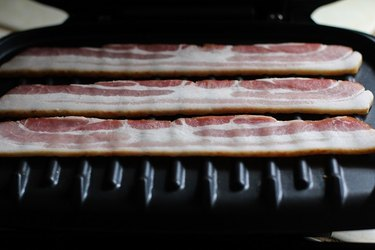 Raw bacon on a George Foreman Grill.