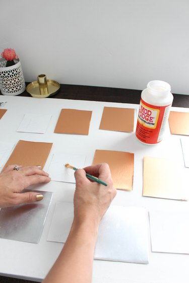 Applying glue to the back of photos