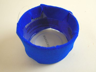 The plastic tub with the sides covered in blue felt.