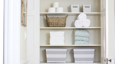 Neatly folded towels in linen closet