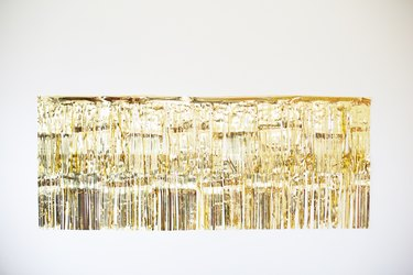 Gold photo backdrop with two rows of garland