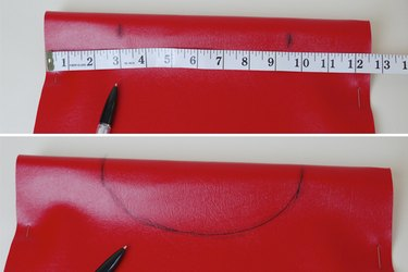 Draw a semicircle for the neck hole.