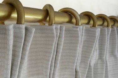 Hang on curtain rod.